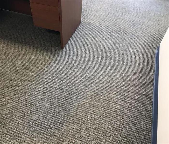 The same area of carpet in an office space after we had dried it to industry standards