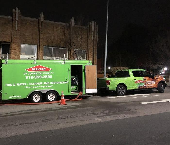 SERVPRO truck and trailer in front of a business
